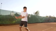 Young Tennis Player Hitting The Ball With Forehand Stroke video