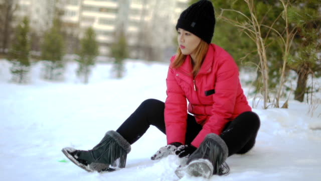 Young Thai Woman playing with snow video