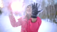 Young Thai Woman throwing up snow slowmotion video