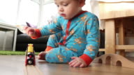 Young Toddler Playing With His Train Set video