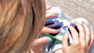 Young urban girl with cellphone outdoors. video