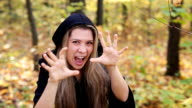 Young witch in a autumn forest video
