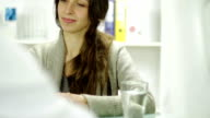 Young Woman Accepting Prescription at Doctor Office video