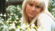 HD DOLLY: Young Woman Among Spring Flowers video