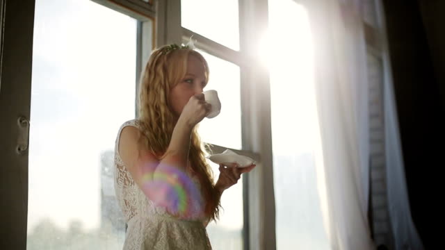 Young woman and her morning coffee video