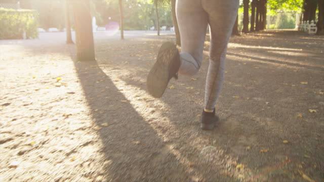 Young Woman and Man Running Together Forward Outwards Camera in Bright Sunny Day video