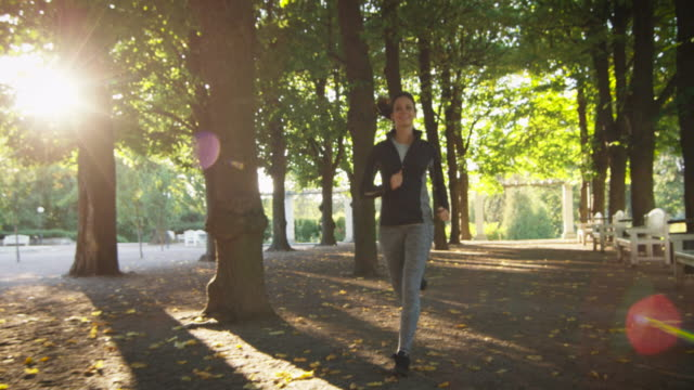Young Woman and Man Running Together Forward Towards Camera in Bright Sunny Day video