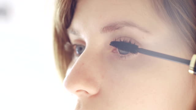 Young woman applying mascara video