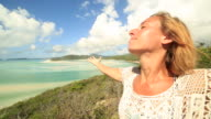 Young woman arms outstretched at Hill Inlet video