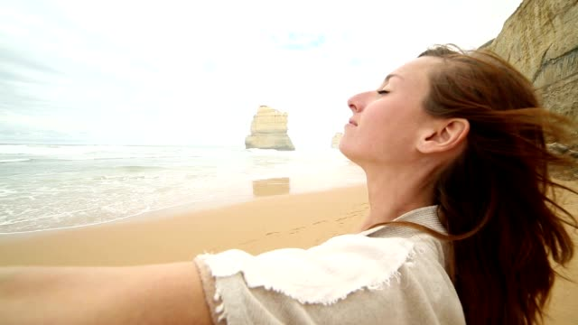 Young woman arms outstretched on Gibsons steps beach, Australia video