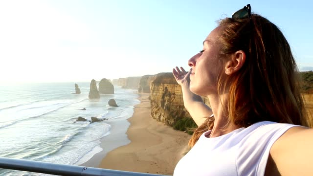 Young woman arms outstretches at the Twelve Apostles-Australia video