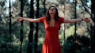 Young woman arms raised enjoying nature video