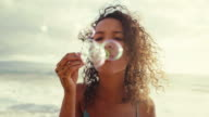 Young Woman Blowing Bubbles video