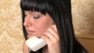 Young woman bored, irritated and listening on phone. video