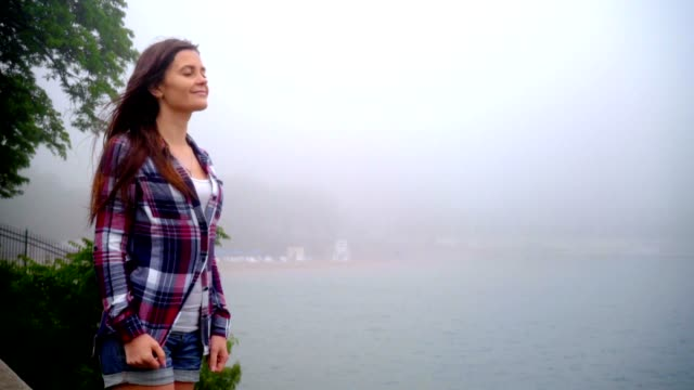 Young woman breathing fresh air. Freedom concept. Walking woman breathing video