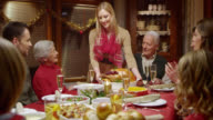 Young woman bringing turkey to the Christmas table video