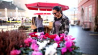 Young woman buying flowers video