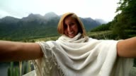 Young woman by the lake takes selfie portrait, New Zealand video