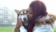 Young woman caresses her dog - Slow Motion video