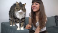 Young Woman Caressing Her Cat video