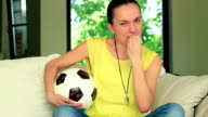 Young woman celebrating soccer goal, slow motion video