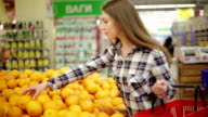 Young woman chooses products in the supermarket video