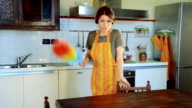 young woman cleaning and dancing video