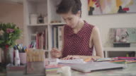 4K: Young Woman Coloring Book In Her Office. video