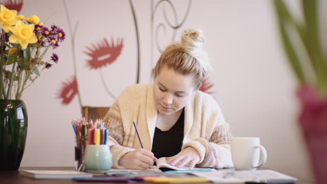 Young woman coloring video