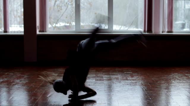 Young woman dancing breakdance, The dark silhouette of dancing girl video