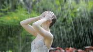 Young woman dancing in the rain video