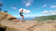 Young woman descending down the path in amazing volcanic mountain range video