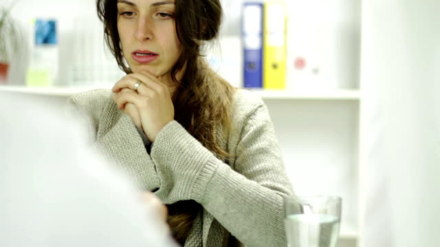 Young Woman Doctor Office Receiving Bad News Upset Crying video