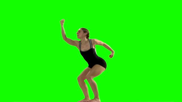 Young woman doing a modern dance piece. Green screen. video