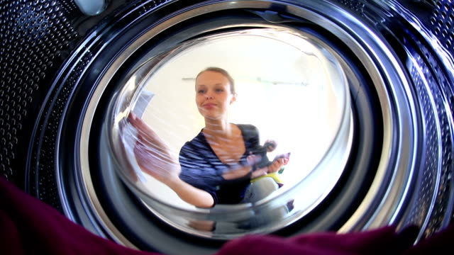 Young woman doing laundry video