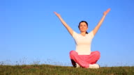 Young woman doing meditation , outdoor. video