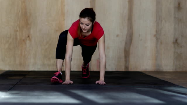 Young Woman Doing Push Ups Exercise During Workout Training At Gym video