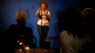 Young woman doing stand up video