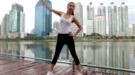 Young woman doing stretching exercise video