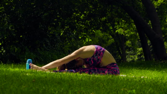Young woman doing yoga exercises video