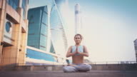 Young Woman Doing Yoga Meditation Exercises at Sunset video