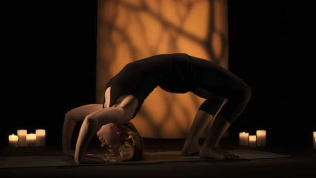 HD DOLLY: Young Woman Doing Yoga video