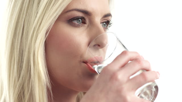 Young woman drinking a water video