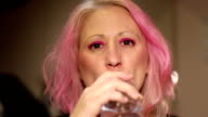 young woman drinking bottle video