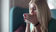 Young woman drinking coffee and enjoying. video