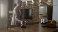 Young woman drinking coffee in the morning video