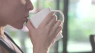 Young woman drinking coffee video