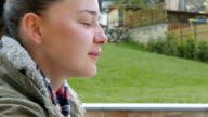 Young woman drinking cup of coffee and enjoying peaceful nature video