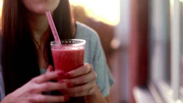 Young woman drinking fruit smoothie video