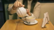 Young woman drinking hot tea in the teahouse. video